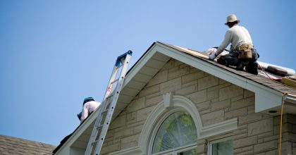 Workers installing new roof on a home